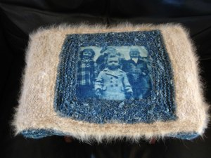 a footstool i made for my father. i made a cyanotype print on fabric, of himself, two of his sisters and a neighbor girl. the blue yarn is handspun soy silk that i dyed with indigo; the fawn yarn is the undercoat of our family dog, coby.
